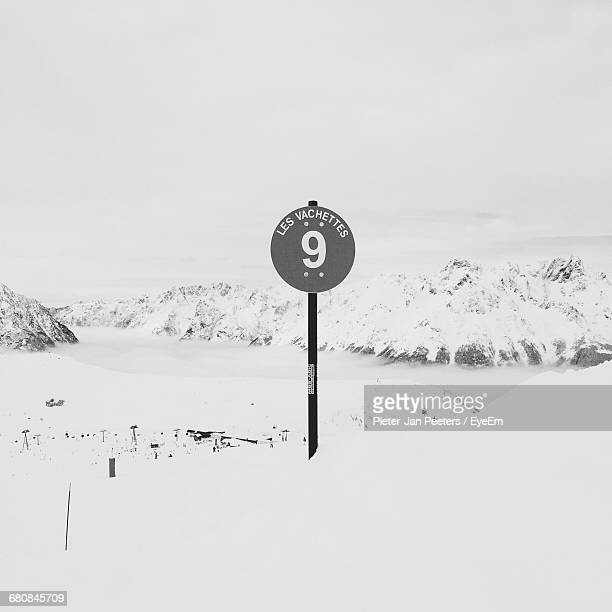 Signboard On Snow Covered Landscape