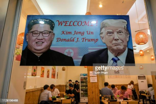A signboard welcomes the upcoming summit between US President Donald Trump and North Korean leader Kim Jong Un at South Korean restaurant in Tu Liem...