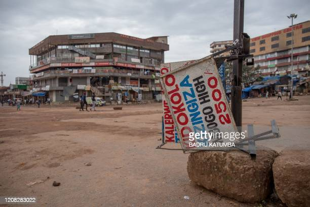 Signboards are left at an empty taxi park in Kampala Uganda on March 26 after Ugandan President Yoweri Museveni directed the public to stay home for...