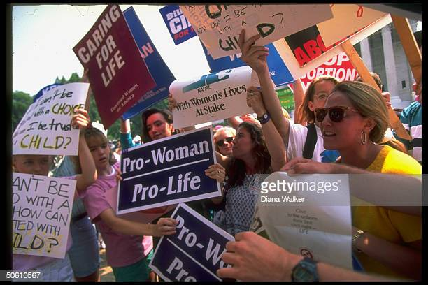 Signcarrying prochoice pro life advocates clashing outside Supreme Court demonstrating re PA case ruling imperiling 1973 Roe vs Wade decision...