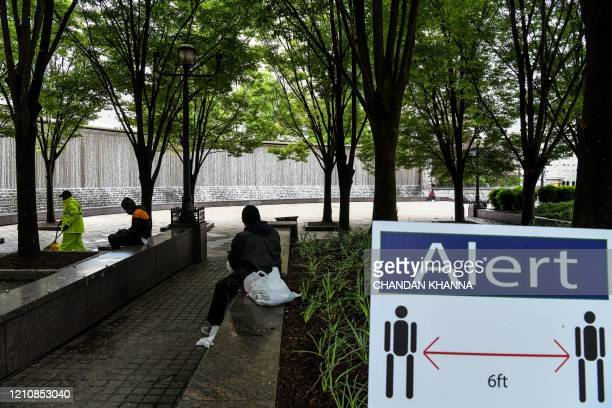 A signdisplays social distancing rules at a park in downtown Atlanta Georgia on April 23 2020 The US state of Georgia takes a massive gamble on April...