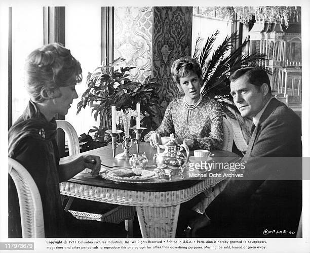 Signe Hasso, Mary Ure, and Robert Shaw have discussion around the table in a scene from the film 'A Reflection of Fear', 1973.