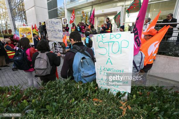 stop to tax evasion » is seen outside the McDonald's headquarters in France as the companys employees and union members protest against the tax...