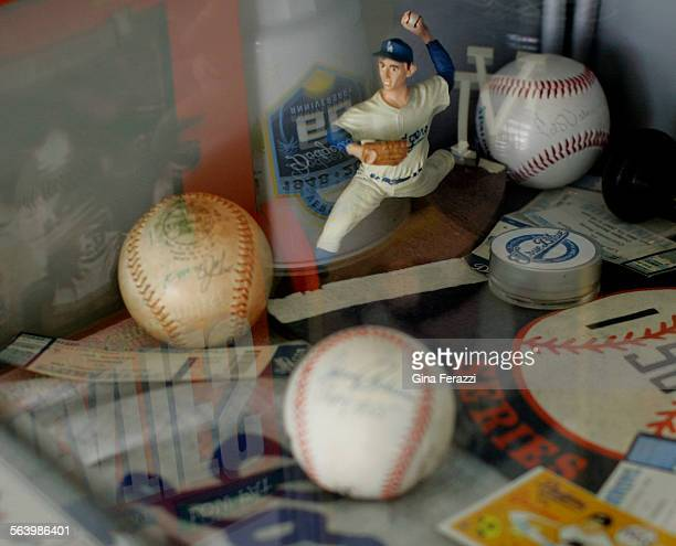 Signed baseballs and other Dodger memorabilia are held in a glass case at True Blue tattoo shop off Hollywood Boulevard in Los Angeles on May 1 2008