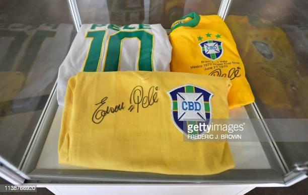 Signed Pele jerseys, worn for Brazil and the New York Cosmos, on display in Beverly Hills, California on April 22, 2019 ahead of auction at Julien's...