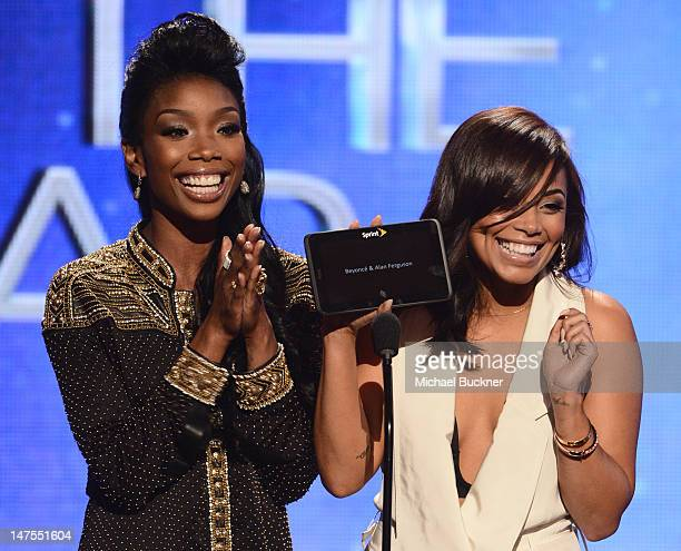 Signer Brandy Norwoord and actress Lauren London present an award onstage during the 2012 BET Awards at The Shrine Auditorium on July 1 2012 in Los...