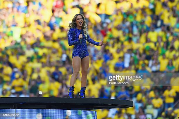 Signer Claudia Leitte performs during the Opening Ceremony of the 2014 FIFA World Cup Brazil prior to the Group A match between Brazil and Croatia at...