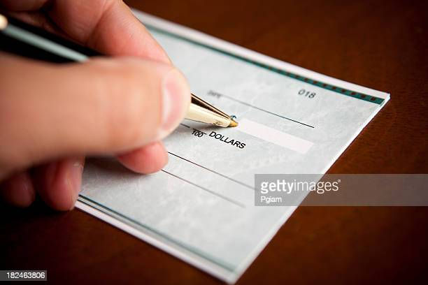 Signing a check with in pen