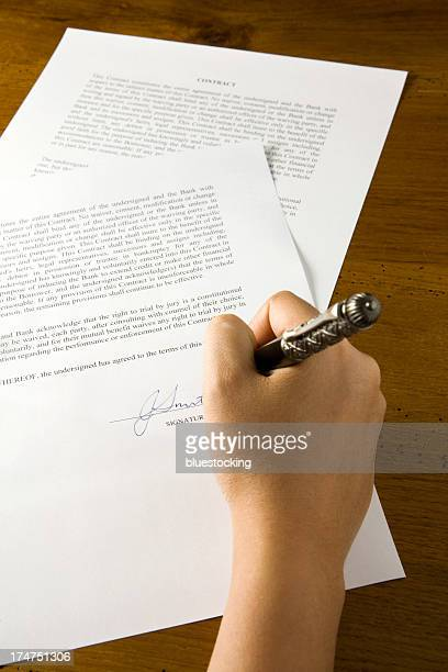 signing a contract - deed stock photos and pictures