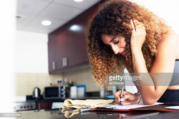 signing a document - expatriate stock pictures, royalty-free photos & images