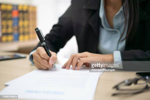 signing agreement - form filling stock pictures, royalty-free photos & images