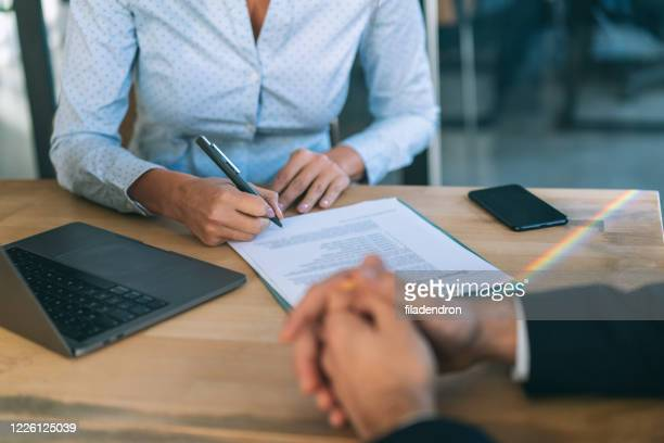signing contract - contract stock pictures, royalty-free photos & images
