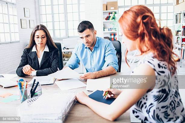 signing papers at the office - ginger banks stock pictures, royalty-free photos & images