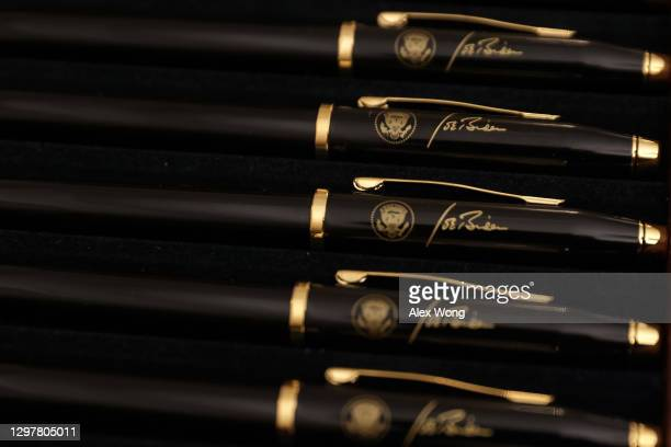 Signing pens with the signature of U.S. President Joe Biden are seen prior to an event at the State Dining Room of the White House January 21, 2021...