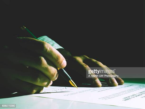 signing... - signing stock pictures, royalty-free photos & images