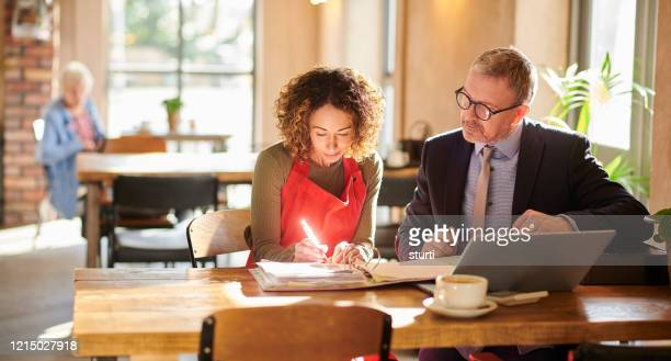 signing the agreement - bank manager stock pictures, royalty-free photos & images