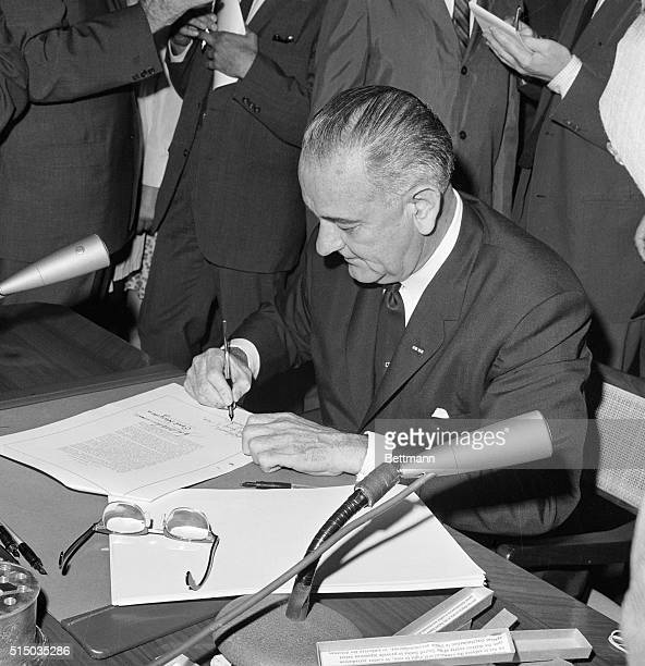 Signing The Bill. Washington: President Johnson signs the Civil Rights Bill into law of the land at the White House today. The Chief Executive signed...