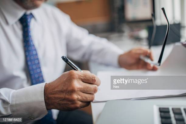 signing the document in the office - politician stock pictures, royalty-free photos & images