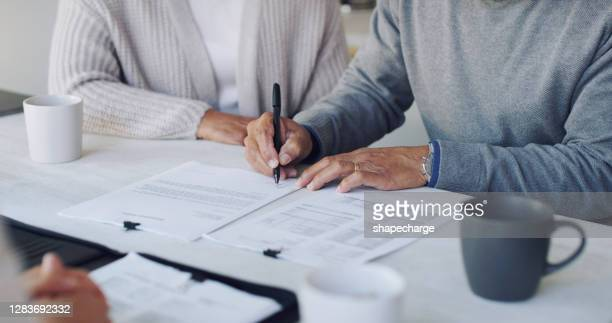 signing up for a secure future - contract stock pictures, royalty-free photos & images