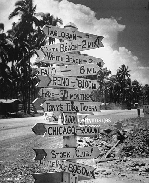 Signpost at a military base in Tacloban, Philippines, points to the different cities American soldiers call home, including Chicago, New York, and...