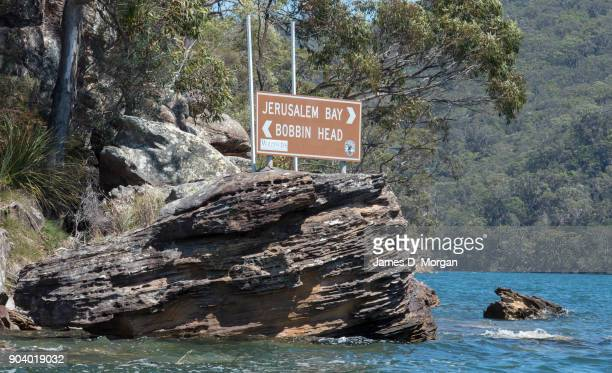 A signpost beside the Hawkesbury River directing to Jerusalem Bay and Bobbin Head on January 08 2018 in Sydney Australia