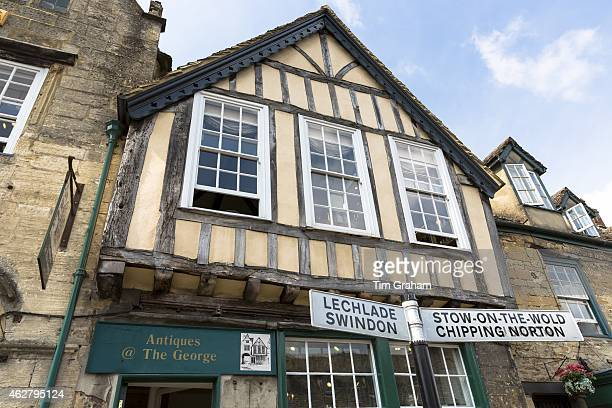 Signpost by Antique Shop for StowontheWold Chipping Norton Lechlade Swindon in Burford High Street The Cotswolds UK
