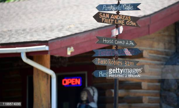 A signpost in front of the Parkfield Cafe offers information and directions to various places including the nearby San Andreas Fault which runs under...