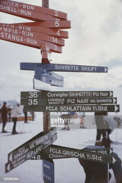 A signpost indicating various ski slopes and toboggan tracks in the resort of St Moritz Switzerland March 1963