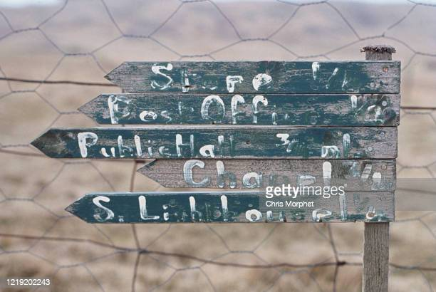 Signpost on Fair Isle, Shetland Islands, Scotland, June 1970. The sign gives directions to the store, post office, Public Hall, Chapel and South...