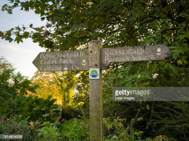 Signpost on the Culbone to Porlock Weir section of the South West Coast Path in the Exmoor National Park.