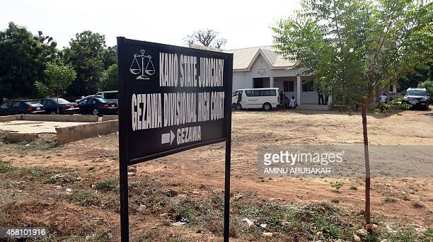 Signpost points to Kano state High court in the village of Gezawa outside Kano where 14-year old Wasila Tasiu is standing trial for the murder of her...