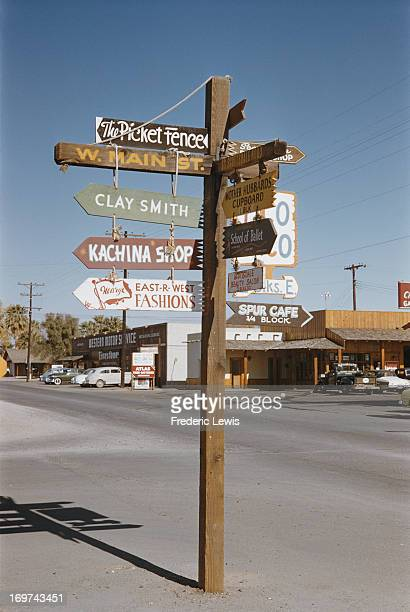 A signpost showing directions to local shops in Scottsdale Arizona circa 1962