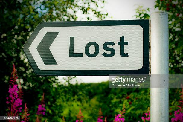 signpost to lost - catherine macbride stock photos and pictures