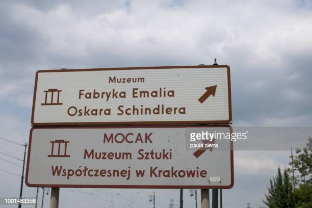 signpost to oskar schindler´s factory and the museum of the contemporary art - oskar schindler imagens e fotografias de stock