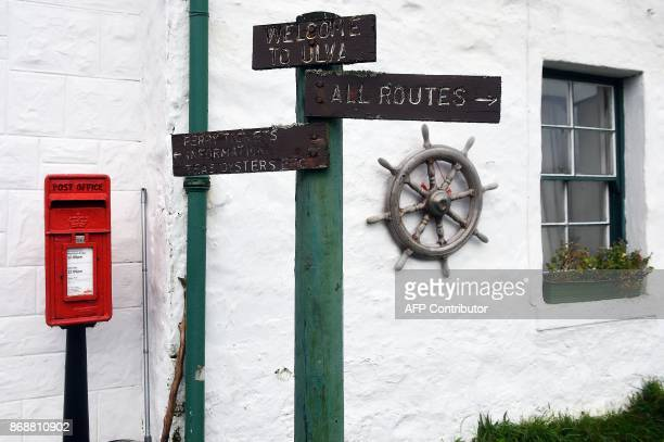 A signpost welcomes visitors to the Isle of Ulva off Scotland's west coast on October 20 2017 When tycoons in helicopters began landing on Scotland's...
