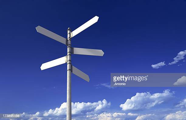signpost with three blank signs on sky backgrounds - crossroad stock pictures, royalty-free photos & images