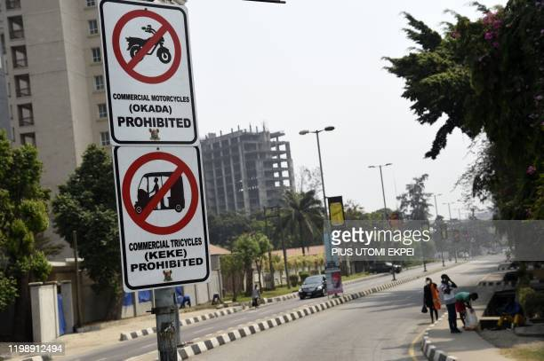 Signposts displayed to reinforce the ban of motorbike taxis and motorised rickshaws, known locally as okada and keke in Lagos, on February 6, 2020. -...