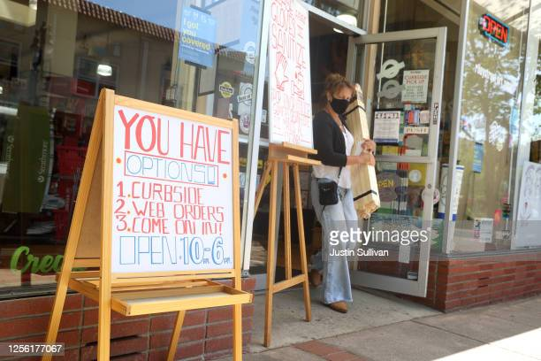 Signs about COVID-19 safety protocols are posted in front of Riley Street Art Supply on July 14, 2020 in San Rafael, California. Governor Gavin...