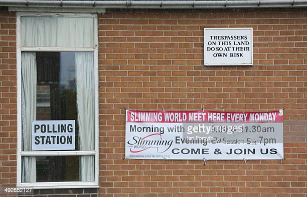 Signs adourn the walls of a polling station during the European and local elections in Redcar on May 22 2014 in Teesside England Millions of voters...