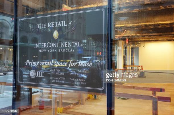 Signs advertise available retail space in the Intercontinental Hotel on Lexington Avenue on February 8 2018 in New York The New York borough of...