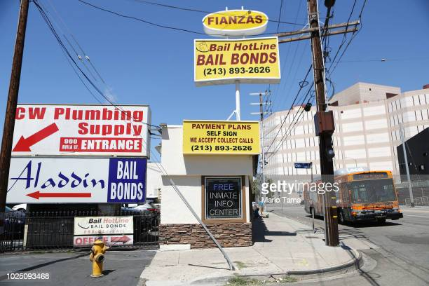 Signs advertise bail bond companies next to the Twin Towers Correctional Facility on August 29, 2018 in Los Angeles, California. California Governor...
