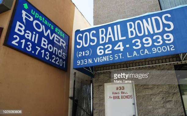 Signs advertise bail bond companies on August 29, 2018 in Los Angeles, California. California Governor Jerry Brown signed a bill yesterday which will...