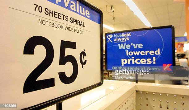 Signs advertise cheap notebooks at a Kmart store August 10 2001 in New York City Discount stores have fared better than upscale shopping centers...