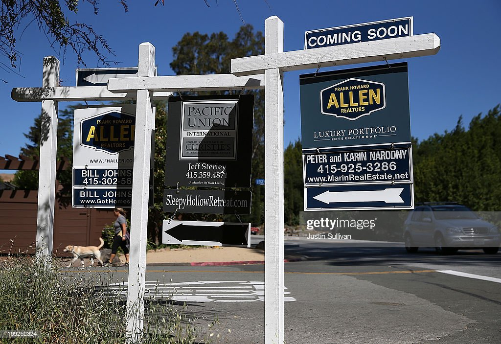 Signs advertising homes for sale are displayed on a street corner on May 22, 2013 in San Anselmo, California. According to a report by the National Association of Realtors, sales of existing homes inched up 0.6% to a seasonally adjusted annual rate of 4.97 million, up from 4.94 million in March, the highest level since 2009.