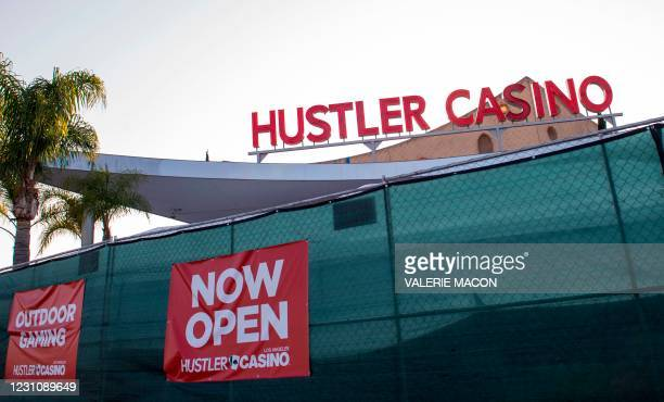 Signs advertising outdoor gaming are seen on the fence of the Hustler Casino on February 10, 2021 in Gardena, a city the South Bay region of Los...