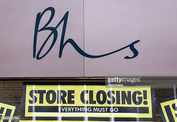 Signs advertising the approaching store closure sit below a logo of the British Home Stores department store in Camberley UK on Tuesday July 26 2016...