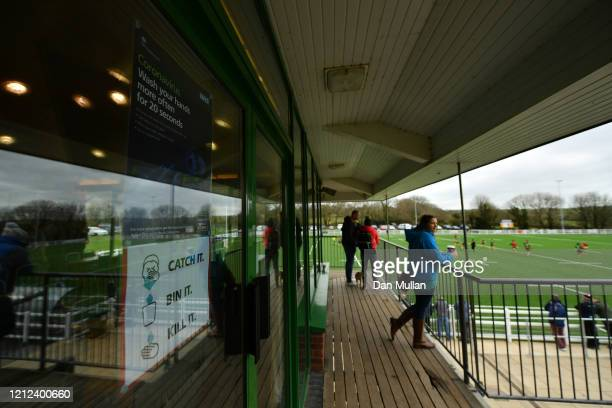 Signs advising people on Coronavirus are displayed at the clubhouse during the Lockie Cup Semi Final match between Old Plymouthian and Mannameadians...