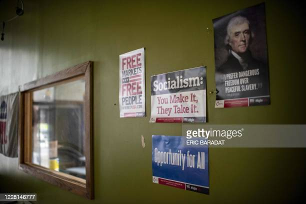 Signs against socialism are seen hanging on the wall as Republican Party Chairman for the Lackawanna County, Lance Stange , gives an interview to AFP...