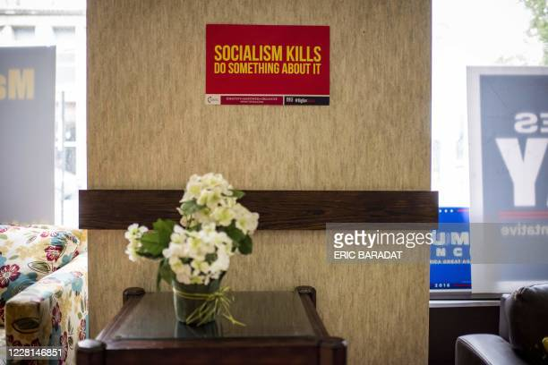 Signs against socialism are seen hanging on the wall as Republican Party Chairman for the Lackawanna County, Lance Strange , gives an interview to...