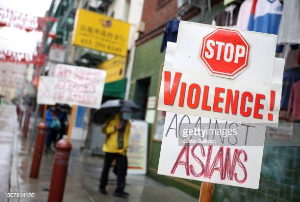 Signs against violence against Asians is posted in front of a store in Chinatown on March 18, 2021 in San Francisco, California. The San Francisco...